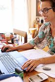 stock photo of independent woman  - Strong independent mature woman with her own business working from home - JPG