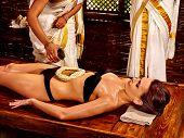 foto of panchakarma  - Young woman having stomach Ayurveda spa treatment - JPG
