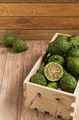 stock photo of dandruff  - Bergamots put together in a wood box - JPG