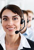 image of helpdesk  - Three call center service operators at work - JPG