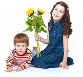 image of brother sister  - Little brother and sister with a bouquet of sunflowers  - JPG