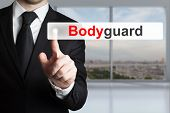 stock photo of bodyguard  - businessman in office pushing flat button bodyguard - JPG