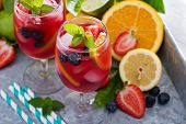 stock photo of sangria  - Ice cold red sangria with citrus fruits and berries in glasses - JPG