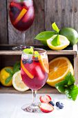 pic of sangria  - Ice cold red sangria with citrus fruits and berries in glasses - JPG