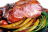image of chive  - roast red beef meat bbq bloc served on black plate  with green chives adn red hot pepper on black plate isolated over white background - JPG