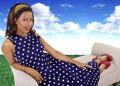 pic of surrealism  - black female in a vintage polka dot dress in a surreal outdoors setting - JPG