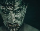 foto of horror  - Portrait of terrible zombie man in blood Halloween or horror theme - JPG