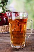 foto of jug  - Full jug of apple juice and fruits on bright background - JPG
