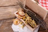 stock photo of roughage  - Different dried herbs and lemon on table close up - JPG