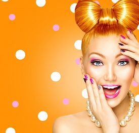 picture of bowing  - Beauty fashion surprised happy model girl with funny bow hairstyle - JPG