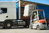 Loading works. Forklift with load and lorry truck poster