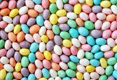 Jelly bean background.  Close-up of speckled, pastel colored jelly beans.