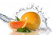 Water splash on orange with mint isolated on white