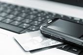 pic of mobile-phone  - Credit cards and mobile phone on the notebook - JPG