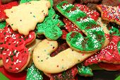 stock photo of christmas cookie  - Red green and white Christmas cookies with sprinkles in a pile - JPG