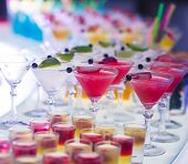 Beautiful Row Line Of Different Colored Alcohol Cocktails With Mint On A Open Air Party, Martini, Vo poster