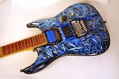 foto of stratocaster  - photo of a hand painted custom electric guitar with bright blue white and black coloring - JPG