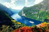 Breathtaking view of Sunnylvsfjorden fjord and famous Seven Sisters waterfalls, near Geiranger villa poster
