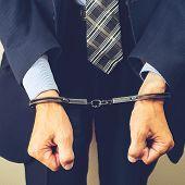 Arrested Businessman In Handcuffs. Businessman Bribetaker Or Briber, Toned Image. Concept Of Fraud,  poster