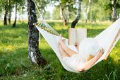 Woman Resting In Hammock Outdoors. Relax And Reading The Book. poster