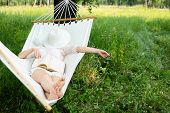 Woman Resting In Hammock. Sleeping Outdoors. poster