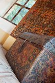picture of ironbound  - Detailed view of a colorful carved chest in a castle - JPG