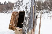 Open Well At The Edge Of The Forest In Russian Village With Old Typical Tools (ice Picks And Ladles) poster