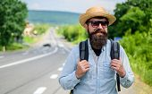 Look For Fellow Travelers. Tips Of Experienced Tourist. Man Bearded Hipster Tourist At Edge Of Highw poster