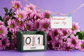 May 1st. Image Of May 1 Calendar On Floral Background With Flowers, Empty Space For Text. Internatio poster