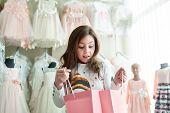 Cute Little Girl On Shopping. Portrait Of A Kid With Shopping Bags. Child In Dress, Sunglasses And S poster