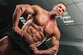Mature Bodybuilder With Naked Torso Showing Sixpack Abdominal And Muscular Body. Strong Man Posing I poster