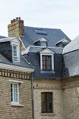 Paris Skyline With Roofs, Chimneys And Mansard Stores. Typical Old Paris Architecture, Beautiful Fac poster