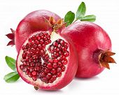 stock photo of pomegranate  - Ripe pomegranates with leaves isolated on a white background - JPG