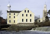stock photo of chafing  - Slater Mill on the Blackstone River in Pawtucket RI