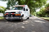 3/4 view of an ambulance parked in a residential area of a city