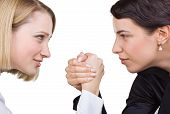 Two Business Women Look At Each Other's Eyes