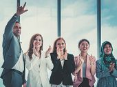 Diverse Business Team Is Clapping For Success poster