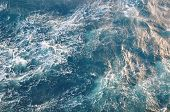 Surface Of Sea Water. Blue Cold Frothy Wavy Aqua Background. Open Deep Sea, View From Above. poster