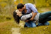 Portrait Of A Couple In Love In Autumn Background