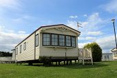 Modern static caravan on campsite during summer, holiday or vacation scene.