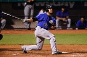 CENTRAL ISLIP-JULY 21: Sugar Land Skeeters outfielder Bubba Bell (10) gets a hit against the Long Is