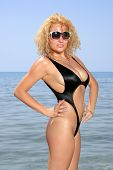 pic of micro bikini  - Girl on a tropical beach with sunglasses - JPG