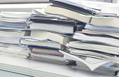 foto of mayhem  - Some office documents and books in  unorganized position - JPG