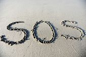 SOS on sand beach