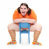foto of pubescent  - Crazy teenager on a blue chair - JPG