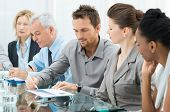 stock photo of meeting  - Group Of Business People Are Focused On The Job - JPG