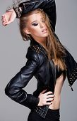 Sexy Model Wearing Leather Jacket And Black Skirt Posing Fashion In The Studio
