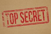 stock photo of top-secret  - Top secret rubber stamp impression on brown paper background - JPG
