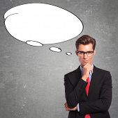 young business man with a big speech bubble exiting his head