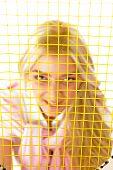 Woman Looking Through Tennis Racket